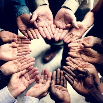 group-of-diverse-hands-in-a-circle-PWF9NP6